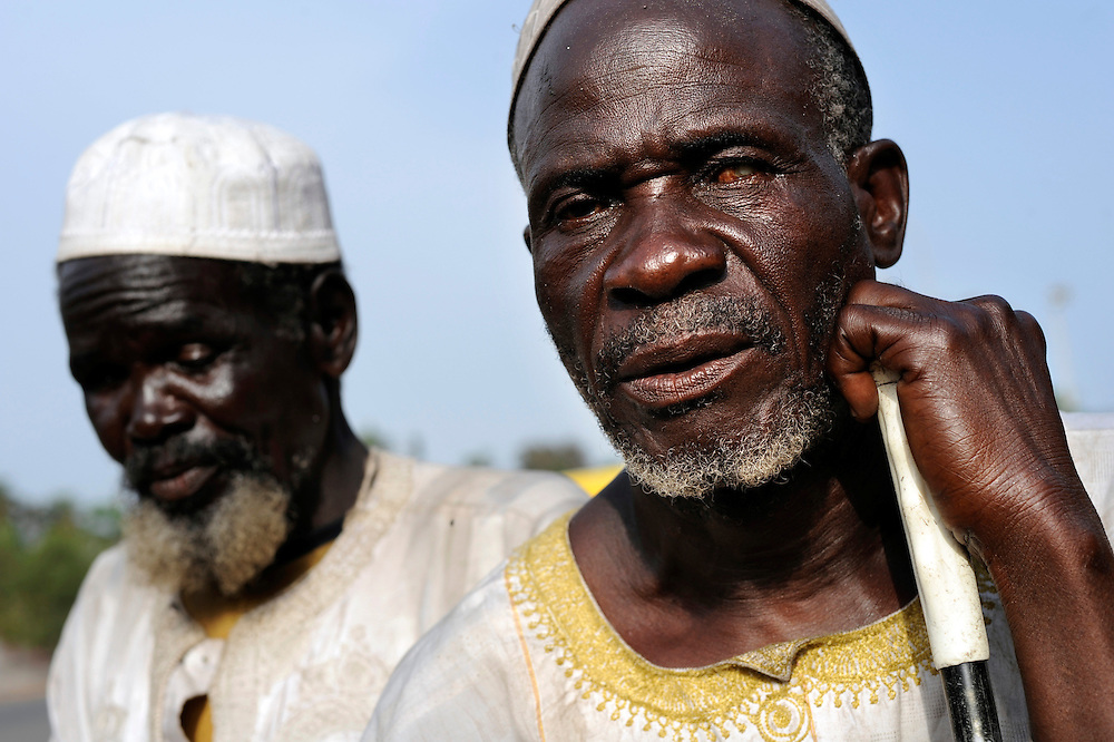 February 2008 -  African blind men  beg in the early morning in the streets of Cotonou, Benin.