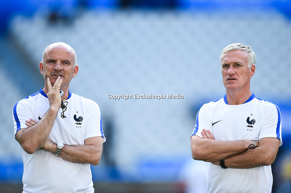 PARIS, FRANCE - JUNE 09: (CHINA OUT) <br /> <br /> Didier Deschamps (R) of France attends a training session on the eve of the beginning of the Euro 2016 European football championships football match against Romania at Stade de France stadium on June 9, 2016 in Saint-Denis near Paris, France. <br /> ©Exclusivepix Media