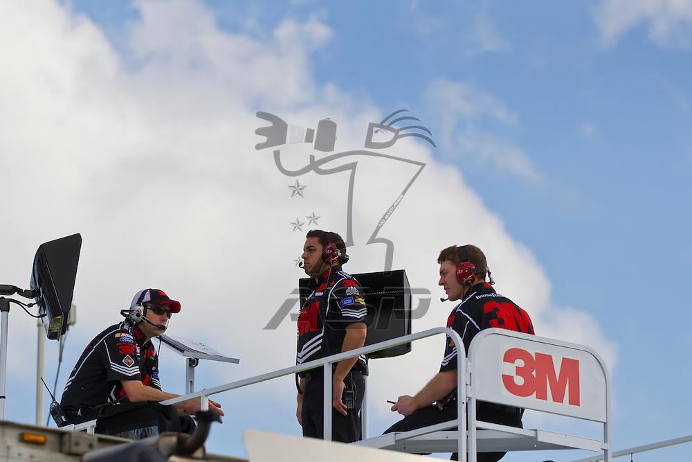 Daytona Beach, FL - {month name} 18, 2012:  The 3M crew watch a practice session for the Daytona 500 at the Daytona International Speedway in Daytona Beach, FL.