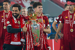 LIVERPOOL, ENGLAND - Wednesday, July 22, 2020: Liverpool's Neco Williams (R) and elite development coach Vitor Matos (L) celebrate with the Premier League trophy as the Reds are crowned Champions after the FA Premier League match between Liverpool FC and Chelsea FC at Anfield. The game was played behind closed doors due to the UK government's social distancing laws during the Coronavirus COVID-19 Pandemic. Liverpool won 5-3. (Pic by David Rawcliffe/Propaganda)
