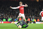 Arsenal Forward Emile Smith-Rowe (55) and Sporting Lisbon Forward Marcos Acuna (9) battle for the ball during the Europa League group stage match between Arsenal and Sporting Lisbon at the Emirates Stadium, London, England on 8 November 2018.