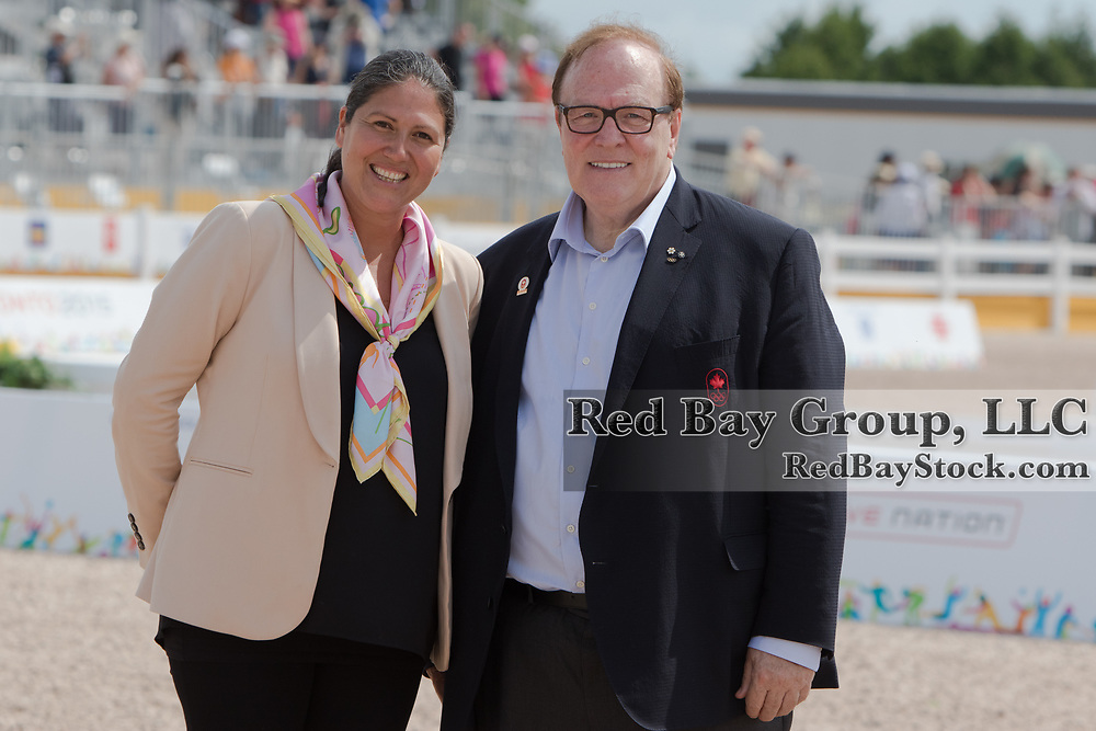 Carmen Barrera, President of the Pan American Equestrian Confederation with Marcel Aubut, OC OQ, president of the Canadian Olympic Committee at the OLG Caledon Pan Am Equestrian Park during the Toronto 2015 Pan American Games in Caledon, Ontario, Canada.