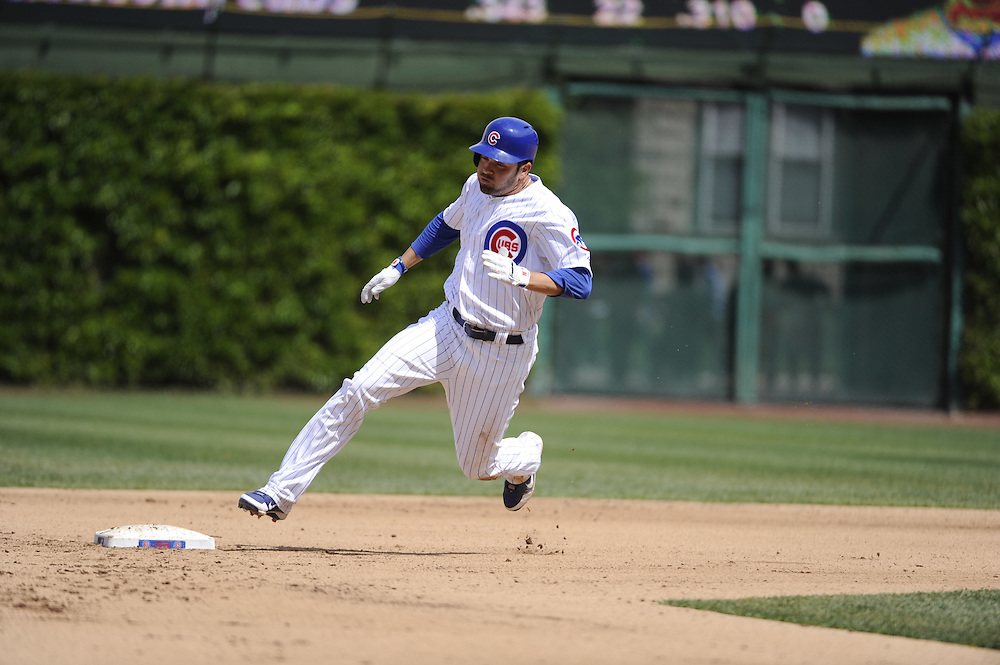 CHICAGO - MAY  04:  David DeJesus #9 of the Chicago Cubs rounds second base while hitting a triple against the Los Angeles Dodgers on May 4, 2012 at Wrigley Field in Chicago, Illinois.  The Cubs defeated the Dodgers 5-4.  (Photo by Ron Vesely)   Subject:  David DeJesus