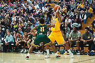 Vermont's Trae Bell-Haynes (2) looks to pass the ball during the men's basketball game between the Lyndon State Hornets and the Vermont Catamounts at Patrick Gym on Saturday afternoon November 19, 2016 in Burlington (BRIAN JENKINS/for the FREE PRESS)