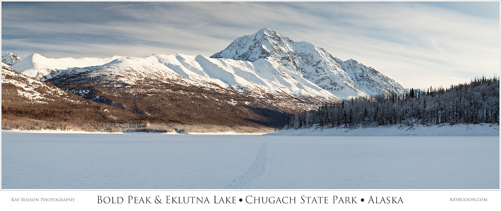 Composite panorama of Bold Peak and Eklutna Lake in Chugach State Park in Southcentral Alaska in mid-winter. Afternoon.