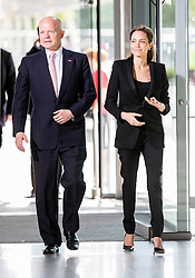 Angelina Jolie, accompanied by Brad Pitt and Foreign Secretary William Hague arrive at the End Sexual Violence in Conflict Summit. Image ©Licensed to i-Images Picture Agency. 12/06/2014. London, United Kingdom. Angelina Jolie. the Excel Centre. Picture by i-Images
