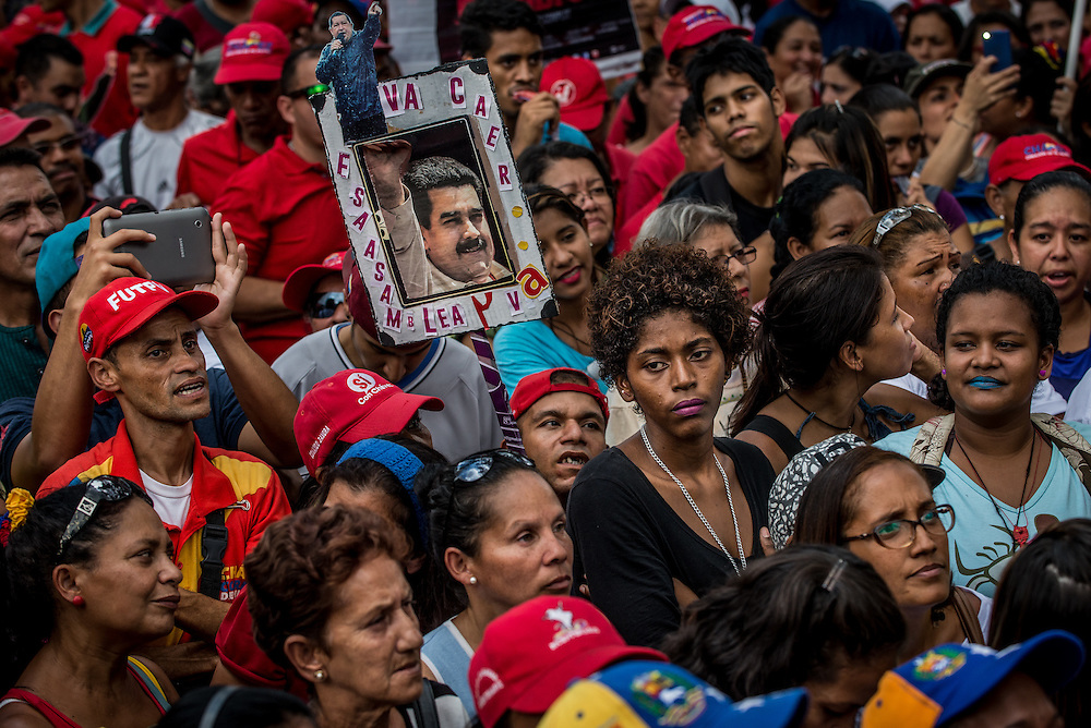 CARACAS, VENEZUELA - NOVEMBER 11, 2016: Government workers and supporters with a sign with photos of President Nicholas Maduro and late president, Hugo Chávez, at a political rally that government workers were obligated to attend to show support for President Nicholas Maduro and his socialist administration.  The 2016 ENCOVI (Survey on Living Conditions in Venezuela) found that a skyrocketing percentage of Venezuelan families are struggling to acquire enough food to eat.  Over 90% of the over 6,000 families surveyed reported not having enough income to buy all the food they need. A shocking 73% of survey respondents reported involuntarily weight loss, an average of 8.7kg each for those that said they involuntarily lost weight.  Food and medicine shortages, skyrocketing inflation and the collapse of social programs are causing working class families that once supported the government and Hugo Chávez's socialist revolution to increasingly become disillusioned with the government, and its commitment to the poor. Many once die-hard Chavistas say they feel abandoned, and no longer support the government. PHOTO: Meridith Kohut