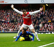 Picture by Andrew Tobin/Focus Images Ltd. 07710 761829. .21/01/12. AThomas Vermaelen (5) of Arsenal tangles with Luis Antonio Valencia (25) of Manchester United during the Barclays Premier League match between Arsenal and Manchester United at Emirates Stadium, London.
