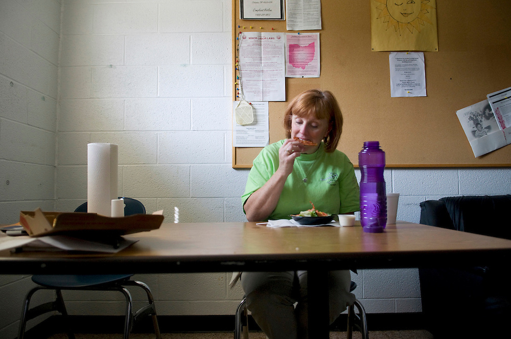 Lissa Riley has a quiet moment during a break for lunch in the teachers' lounge..