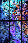 Birds in flight, from the right lancet window of the 'Les Grandes Heures de Reims stained glass window, 1974, by Marc Chagall, 1887-1985, with the studio of Jacques Simon, in the axial chapel of the apse of the Cathedrale Notre-Dame de Reims or Reims Cathedral, Reims, Champagne-Ardenne, France. The cathedral was built 1211-75 in French Gothic style with work continuing into the 14th century, and was listed as a UNESCO World Heritage Site in 1991. Picture by Manuel Cohen