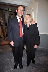 RICHARD DESMOND and his wife JANET at the 3rd Fortune Forum Summit held at The Dorchester Hotel, Park Lane, London on 3rd March 2009.