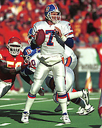 Denver quarterback John Elway (7) drops back to pass against the Kansas City Chiefs at Arrowhead Stadium in Kansas City, Missouri in 1993.