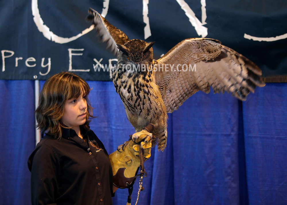 "Suffern, New York - Talon Skye Schumacher holds a European Eagle owl (Bubo bubo) during a presentation at the ""Talons! A Birds of Prey Experience"" exhibit at the Northeast Astronomy Forum at Rockland Community College on April 17, 2011."