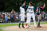 Hunter Bishop, right, celebrates with Michael Gasper of the Brewster Whitecaps during game one of the Cape Cod League Championship Series against the Bourne Braves at Stony Brook Field on August 11, 2017 in Brewster, Massachusetts.