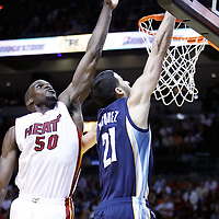 12 March 2011: Miami Heat center Joel Anthony (50) blocks Memphis Grizzlies guard Greivis Vasquez (21) during the Miami Heat 118-85 victory over the Memphis Grizzlies at the AmericanAirlines Arena, Miami, Florida, USA. **
