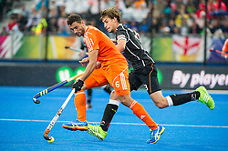 The Netherlands Glenn Schuurman is watched by Florian Fuchs of Germany. The Netherlands v Germany - Final Unibet EuroHockey Championships, Lee Valley Hockey & Tennis Centre, London, UK on 29 August 2015. Photo: Simon Parker