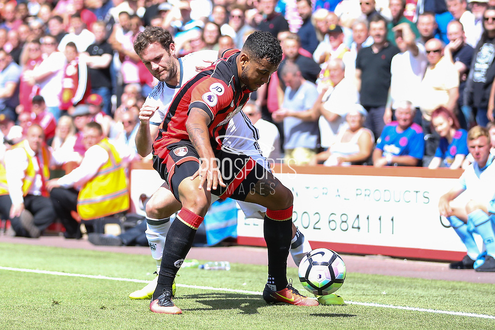 Juan Mata Midfielder of Manchester United and Bournemouth Forward Joshua King tackle during the Premier League match between Bournemouth and Manchester United at the Vitality Stadium, Bournemouth, England on 14 August 2016. Photo by Phil Duncan.