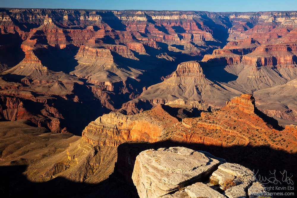 The south rim of the Grand Canyon casts its shadow into the canyon in the late afternoon in this view from near Pipe Creek Vista, Grand Canyon National Park, Arizona.