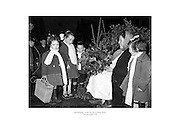 Berried holly wreaths for sale on Henry Street.<br /> <br /> 15th December 1958<br /> 15/12/1958