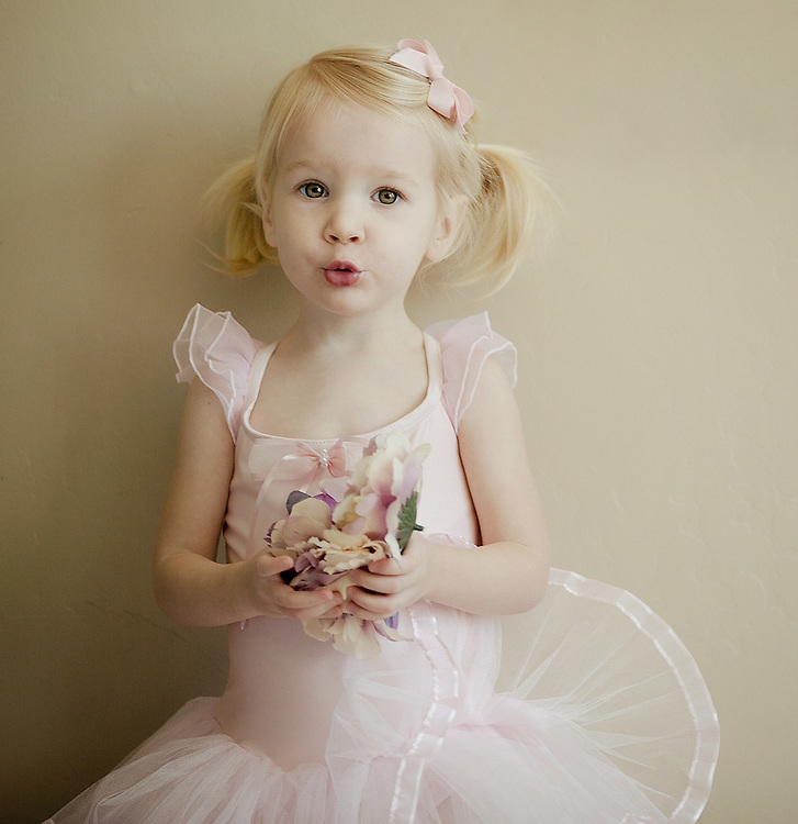 Girl toddler in pink ballerina dress.