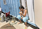 woman living  in a house-container of the Municipality of Palermo  since seven years, after being  evicted from  home.<br />