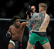 Charlie Ward (green shorts) in action against Galore Bofando during their welterweight bout during the UFC Fight Night at the SSE Hyrdo, Glasgow.