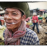 Former Khmer Rouge soldier smokes at a market in Pailin, along the Cambodia-Thailand border.