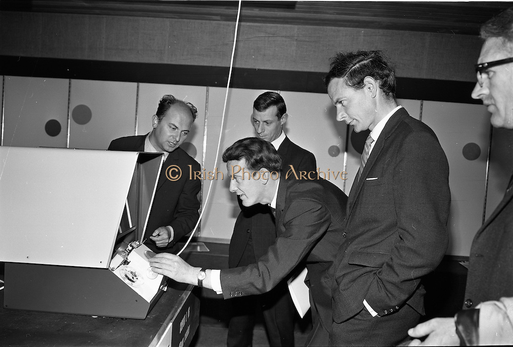 "19/09/1967<br /> 09/19/1967<br /> 19 September 1967<br /> Opening of Agfa-Gevaert exhibition at the Building Centre, Lower Baggot Street, Dublin. Exhibition ""Microfilms in the Space Age"" demonstrating microfilming equipment and facilities, most of the equipment was exclusive to Agfa-Gevaert Limited. Pictured (l-r) are: Mr G. Gonsztonwi (Gosztonyi?) AgFa-Gevaert, London; Mr L.A. Mongey, Memo Ltd.; Mr G.E. Ryan, Director Memo Ltd. and J.D. Taylor, Dublin Corporation, viewing some of the equipment."