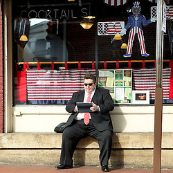 Kyle Green | The Roanoke Times<br /> 2/10/2012 A spectator sits on Main Street after the Washington and Lee mock convention parade in downtown, Lexington, Virginia on Friday.