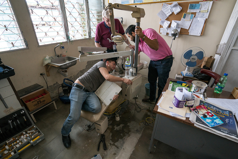 Maintenance workers repair a dental chair at the prison in Santa Rosa de Copan, Copan, Honduras on Feb. 22, 2017. Photo Ken Cedeno