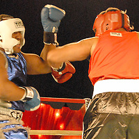 Amateur Heavyweights Shawn Seymore (right) and Dominic Brezeale  box during ``Big Fighters, Big Cause'' charity boxing event at the Santa Monica Pier on Tuesday, May 25, 2010. Seymore won the bout by decision..