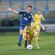 Gavin Rothery (Guiseley) goes down under the challenge of Hamza Bencherif (Halifax) during the Conference Premier League match between FC Halifax Town and Guiseley at the Shay, Halifax, United Kingdom on 5 December 2015. Photo by Mark P Doherty.