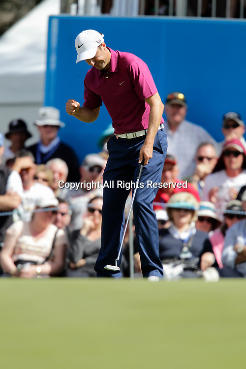 20.10.2013 Perth, Australia. Ross Fisher (ENG) celebrates sinking the putt to give him an equall share of the lead during the final day of the ISPS Handa Perth International Golf Championship from the Lake Karrinyup Country Club.