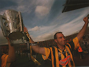 Kilkenny's D J Carey takes the McCarthy Cup on behalf of his country for the 20th time.