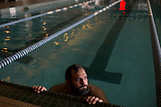 Johny Hendricks cools off in the Lifetime Fitness pool between hot tub sessions while cutting weight the week of his fight in Mansfield, Texas on March 9, 2014.