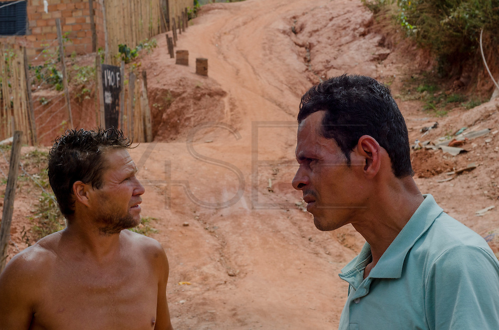 Mr. Matizael, on the left, and Mr. Reinato, on the right, are single fathers who live with their children in Esperança Occupancy, Isidoro area. They are afraid of the future of Isidoro and the possibility of not having home for raising their children.