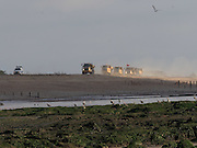 Every year shingle is brought to fPett Level  from the Rye Harbour end  by trucks to try to prevent erosion .  Cliff End, Pett Level, 21 October 2016
