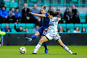 Jane Ross (#13) of Scotland gets a shot away towards goal as Filippa Savva (#19) of Cyprus attempts to make a block during the Women's Euro Qualifiers match between Scotland Women and Cyprus Women at Easter Road, Edinburgh, Scotland on 30 August 2019.