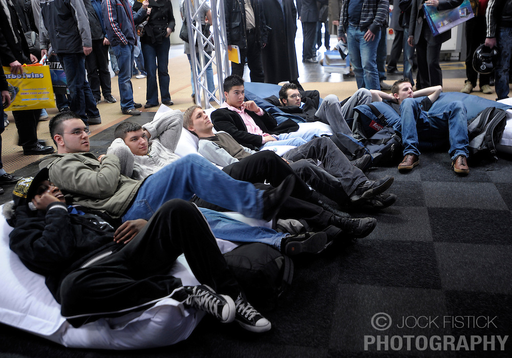 HANNOVER, GERMANY - MARCH-7-2008 - Gamers relax in comfort as they wait for their turn at the controls, in the gaming pavilion at CeBIT. (Photo © Jock Fistick)