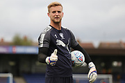 AFC Wimbledon goalkeeper George Long (1) warming up during the EFL Cup match between AFC Wimbledon and Brentford at the Cherry Red Records Stadium, Kingston, England on 8 August 2017. Photo by Matthew Redman.