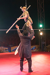 © Licensed to London News Pictures. 22/04/2015. Guildford, UK. Kelly-Marie Blundelltakes a tumble as she is guided through the process by comedy artist Vladimir Georgieski and high wire walker Olga Roxhkovskaya. Liberal Democrat Kelly-Marie Blundell walks the high wire at Moscow State Circus in Guildford. Photo credit : Stephen Simpson/LNP