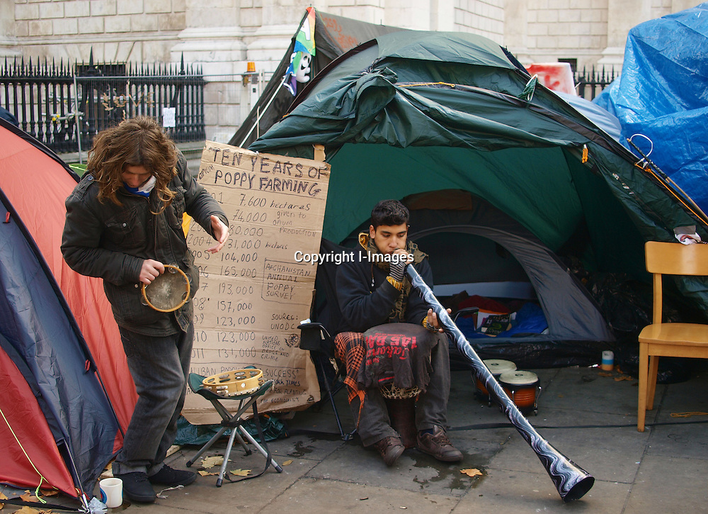 Global protesters wearing the Global Protest mask at their tent city outside St Paul's Cathedral in London Tuesday Nov.15, 2011. New York police have started to evict the Glabal protesters in Wall Street.by morn iImages.co