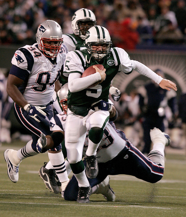New York Jets quarterback Brooks Bollinger trys to break a tackle from richard Seymour of the New England Patriots at Giants Stadium in East Rutherford NJ Monday 26 December 2005