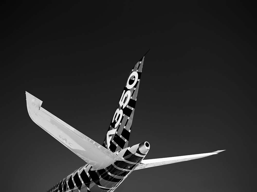 The empennage of an Airbus A-350, photographed during AirVenture 2015 in Oshkosh, Wisconsin.  <br /> <br /> Created by aviation photographer John Slemp of Aerographs Aviation Photography. Clients include Goodyear Aviation Tires, Phillips 66 Aviation Fuels, Smithsonian Air & Space magazine, and The Lindbergh Foundation.  Specialising in high end commercial aviation photography and the supply of aviation stock photography for advertising, corporate, and editorial use.