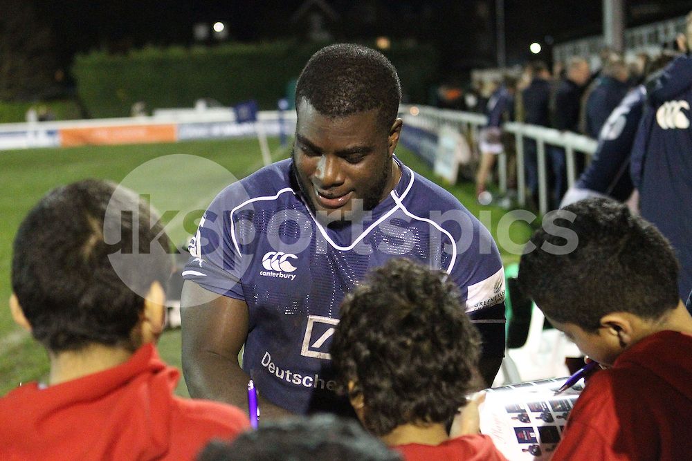 Lovejoy Chawatama signs an autograph for young fans after the Green King IPA Championship match between London Scottish &amp; Jersey at Richmond, Greater London on Friday 14th November 2014<br /> <br /> Photo: Ken Sparks | UK Sports Pics Ltd<br /> London Scottish v Jersey, Green King IPA Championship,14th November 2014<br /> <br /> &copy; UK Sports Pics Ltd. FA Accredited. Football League Licence No:  FL14/15/P5700.Football Conference Licence No: PCONF 051/14 Tel +44(0)7968 045353. email ken@uksportspics.co.uk, 7 Leslie Park Road, East Croydon, Surrey CR0 6TN. Credit UK Sports Pics Ltd