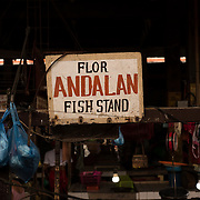 """Indoor market fish stand. <br /> <br /> The SARANGANS showcase enormous cultural diversity of Blaan, Tboli, Tagakaolo, Kalagan, Manobo, Ubo, Muslim tribes and Christian settlers. Hospitable and fun-loving """"Sarangans"""" (people of Sarangani) adhere to a unified direction for development.<br /> Muslim consists of 7 groups; the Lumads, 17; and the migrant settlers, at least 20. The Blaans characterize the largest minority and are distributed in the municipalities of Malapatan, Glan, Alabel, Maasim, and Malungon. A bulk of this tribe is found in Malapatan constituting 37% of the municipal household population.<br /> The Maguindanaos are settled in the municipalities of Malapatan, Maitum, and Maasim; Tbolis reside mostly in Maitum, Kiamba, and Maasim while Tagakaolos subsist entirely in Malungon.<br /> Cebuano settlers are found in Glan and Alabel; Ilonggos are situated in Malungon while the Ilocanos live mostly in Kiamba and Maitum.<br /> Thus, Sarangani's mixed population of Cebuano-speaking Blaans and Muslims in the east coast, Ilocano-speaking Tbolis, Manobos and Muslims in the west coast, and Ilonggo-speaking Blaans and Kaolos in the north uplands, is unique and in harmony."""