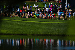 August 10, 2018 - St. Louis, MO, U.S. - ST. LOUIS, MO - AUGUST 10: Reflections of spectators are seen in the water on the third hole during Round 2 of the PGA Championship August 10, 2018, at Bellerive Country Club in St. Louis, MO.  (Photo by Tim Spyers/Icon Sportswire) (Credit Image: © Tim Spyers/Icon SMI via ZUMA Press)