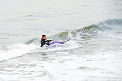 canoeist catches waves towards the beach near Whitby Harbor.September 2010 .Images © Paul David Drabble