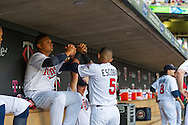 Eduardo Escobar #5 and Oswaldo Arcia #31 of the Minnesota Twins get ready in the dugout before a game against the Kansas City Royals on June 27, 2013 at Target Field in Minneapolis, Minnesota.  The Twins defeated the Royals 3 to 1.  Photo by Ben Krause