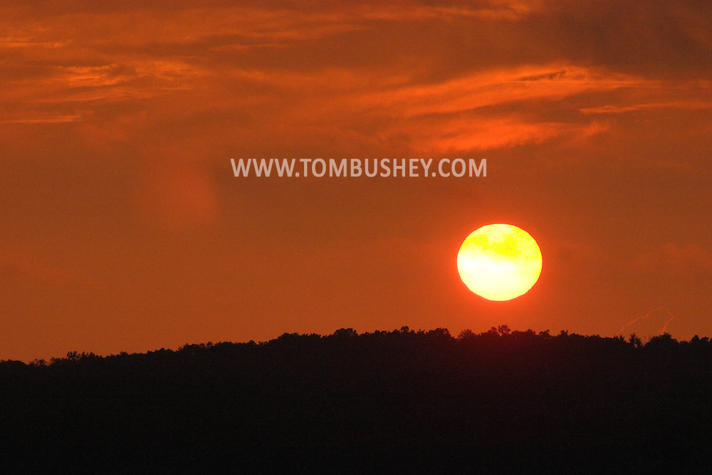 Central Valley, N.Y. - The sun starts to set behind a ridge on a summer evening on June 24, 2006. ©Tom Bushey